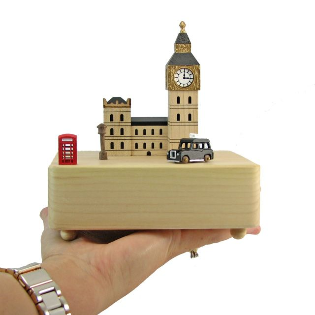 """This unique fine wood crafted music box comes with a miniature London taxi that circles around Big Ben according to the rhythm of the traditional English folk song """"Greensleeves""""  Thanks to its tradem"""