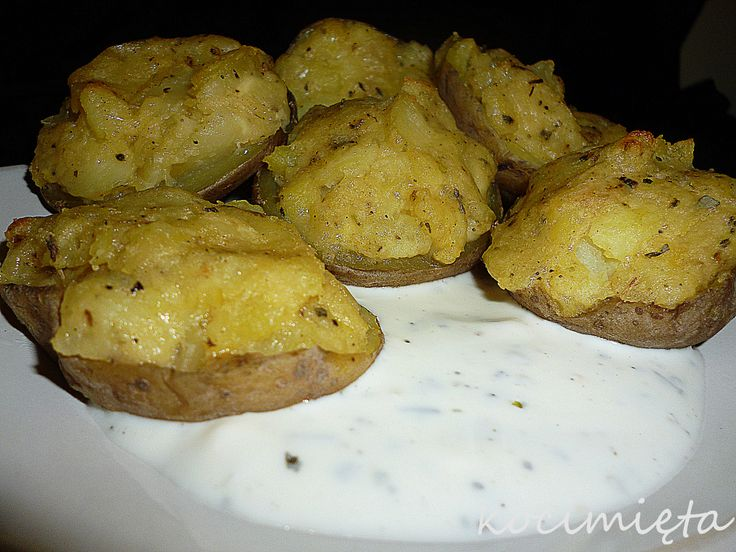 baked potatoes with cheese and garlic sauce