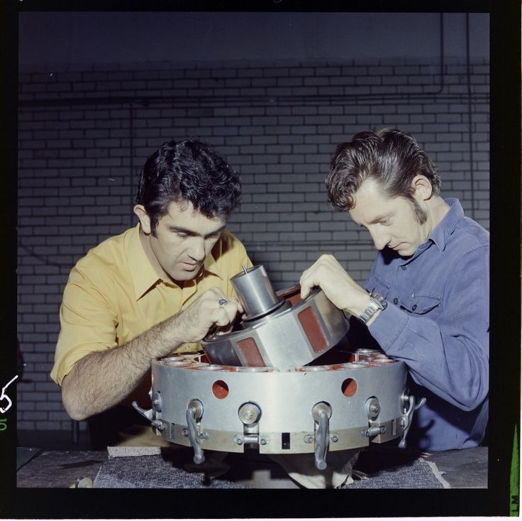 327096PD: Ralph Sarich (left) working on his orbital engine at the premises of Orbital Engineering, Balcatta.  http://encore.slwa.wa.gov.au/iii/encore/record/C__Rb3096480__S%28engineering%29%20f%3Av__P0%2C16__Orightresult__U__X6?lang=eng&suite=def