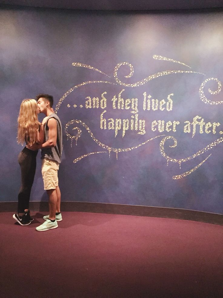 And they lived happily ever after. Disneyland. Couple. Kiss