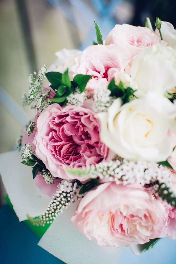 Bride's bouquet. Pink and White roses with sweet peas and greenery.