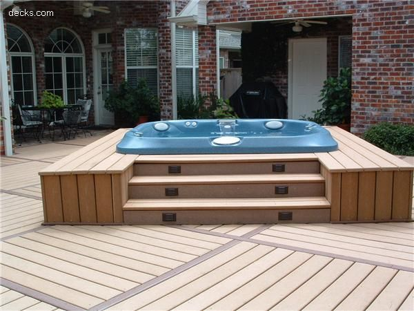 recessed hot tub and stairs up to it and add a pergola for cover