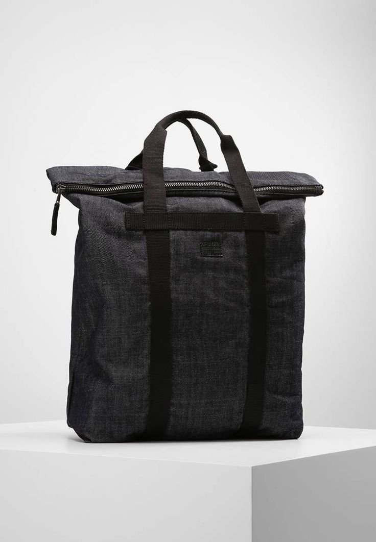 """G-Star. ESTAN  - Tote bag - raw denim. Fastening:Zip. Compartments:mobile phone pocket. length:15.5 """" (Size One Size). width:6.0 """" (Size One Size). Lining:Cotton. carrying handle:3.0 """" (Size One Size). Fabric:Denim. Outer material:cotto..."""