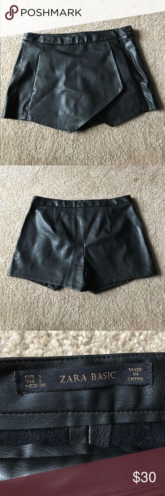 Zara Basic Asymmetrical Black Faux Leather Shorts Zara Basic black Asymmetrical shorts. 100% polyurethane faux leather. Zara Shorts