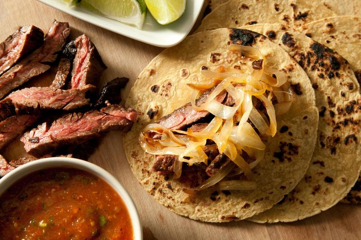 Chipotle Beef Tacos with Caramelized Onions (Tacos de Carne Asada Enchipotlada) ...serve with fresh avocado, salsa, shredded cheeses and sour cream