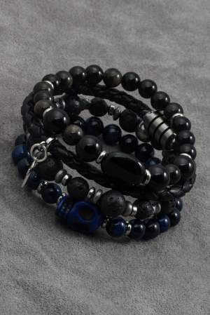 Bracelet for men made of lava balls. Male pattern add spacers made of stainless steel and hematite. The bracelet is made on elastic, so it is convenient and does not require fastening.  Bracelet fits as a supplement to your daily styling.  Jewelry made by hand. Limited edition.