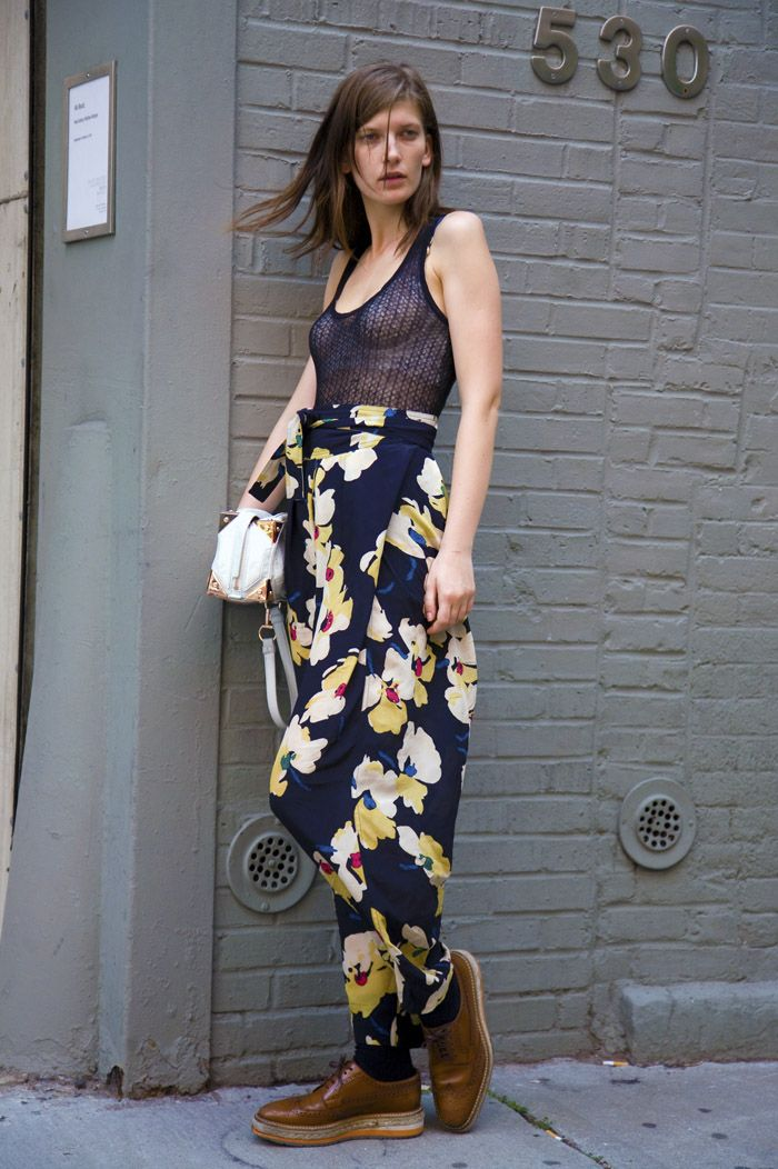 Perfect silhouette for Valerija Kelava wearing floral oversized pants and black mesh top