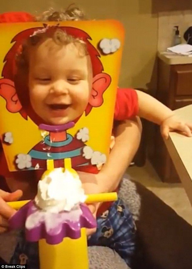 An adorable youngster couldn't stop giggling after playing the popular 'pie face' game wit...