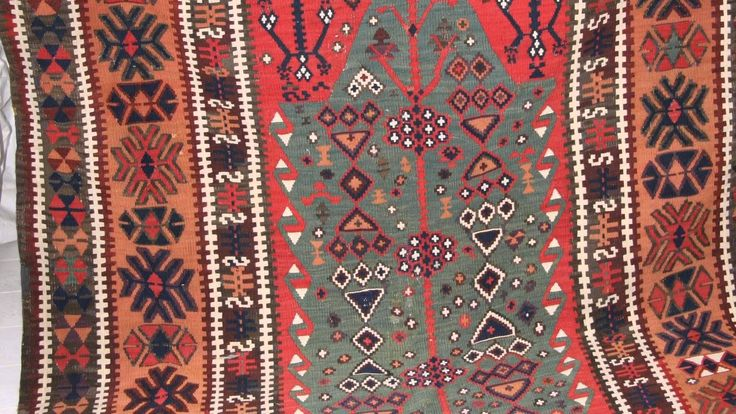 """This beautiful unique handmade wool flat woven Turkish Kilim belongs to the Anatolian Group. Measuring 390x150cm (12'8""""x4'9""""), it was made around the first part of the 20th century with having geometrical central motifs embedded with various objects in similarly patterned borders. A unique characteristic feature about this Kilim is where blue and green main field interact and give such decorative look."""