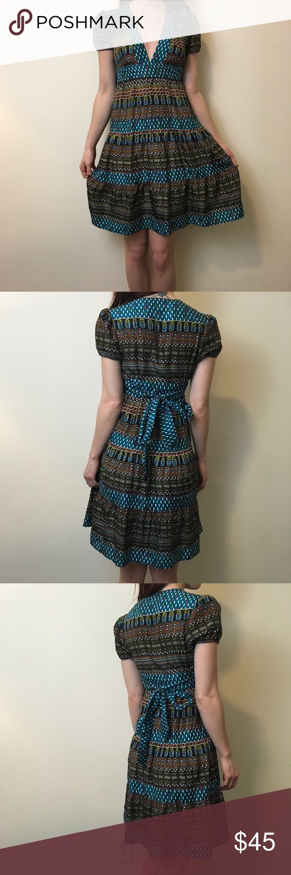 """What Goes Around Comes Around Anthro Silk Dress What goes around comes around by Anthro dress with shirt sleeves and a waist tie- not lined and is a size 0. Worn once and is super cute paired with boots! Bust 15"""" waist 13"""" hips 18"""" length 36"""" Anthropologie Dresses Midi"""