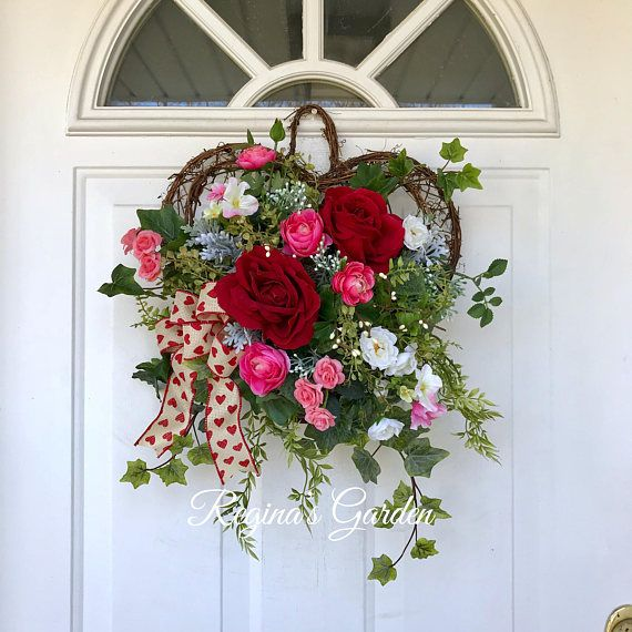 Valentines Day Wreath-Spring Wreath-Wall Basket-Door Basket-Spring Flower Arrangement-Front Door Decor-Red Rose Wreath-Reginas Garden This lovely heart-shaped grapevine basket/wreath is filled with a mixture of roses, ranunculus and a pretty mixture of sweet garden blossoms. Realistic