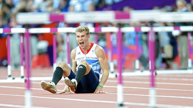 Jack Green of Great Britain reacts afer falling in the Men's 400m Hurdles Semi Final on Day 8 of the London 2012 Olympic Games at Olympic Stadium.