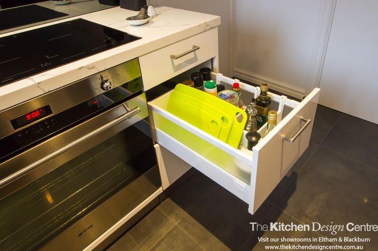 A modern, white kitchen with a walk in pantry and grey mirror splashback. www.thekitchendesigncentre.com.au @thekitchen_designcentre