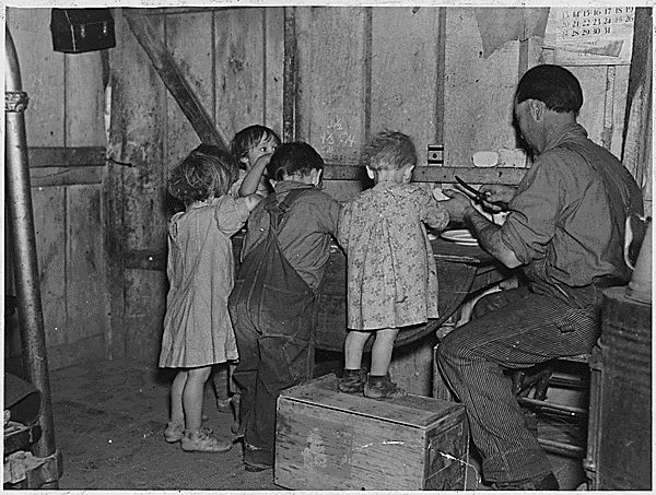 Picture of a family eating Christmas dinner near Smithland, Iowa during the Great Depression. Circa1935