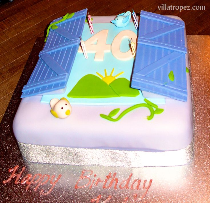 The view of the Provencal hills through the lavender blue shutters of Villa Tropez was the theme of this custom-made birthday cake for a 40th birthday. It was made for a guest renting the villa for their birthday week.