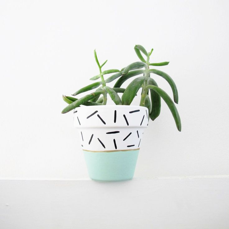 Hand painted plant pot in mint dash design by This Way to the Circus Measures 11cm high, 11cm diameter. Sealed for both water and UV protection