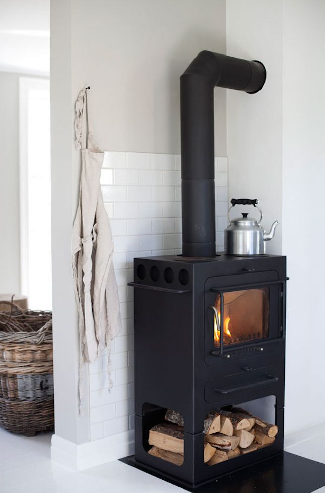 13 Wood Stove Decor Ideas for Your Home via Brit + Co.