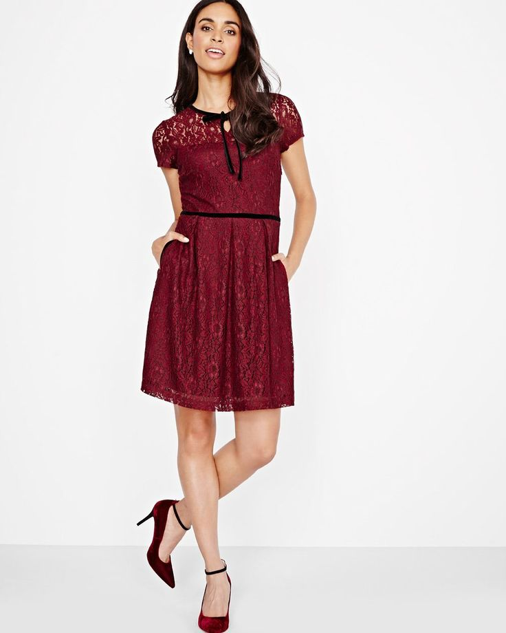 """Look great no matter what's your body type with this sweet two-tone cord lace fit and flare dress with a black velvet bow at the neck.<br /><br />- Short sleeve<br />- Crew neck <br />- Velvet trim, waistband and front tie<br />- Side pockets<br />- Stretch lining with sweetheart neckline<br />- 37'' body length<br />- Our model wears a size Small and is 173cm/5'8""""..."""
