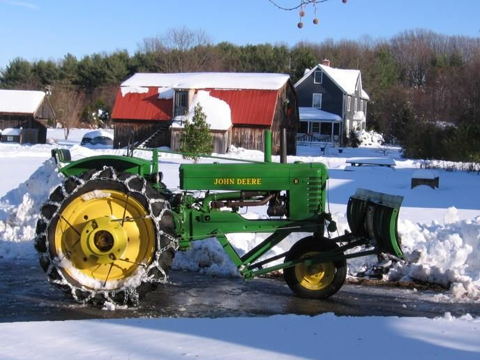 1948 John Deere B with front-mounted ABG90 snow plow attachment.