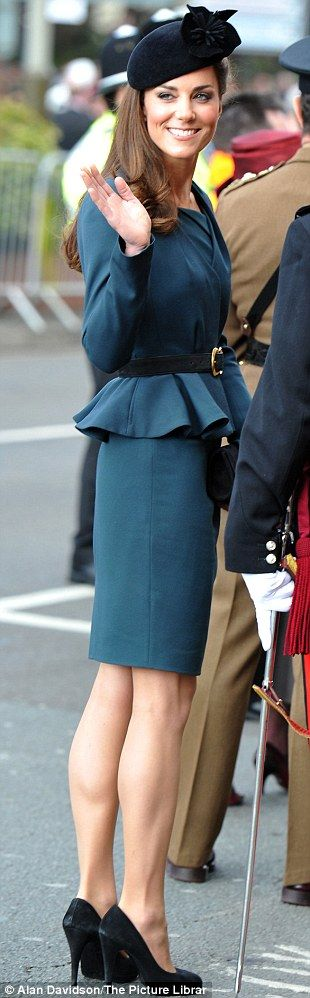 Kate, who channelled 1940's old-school glamour in a teal suit by L.K. Bennett nipped-in at the waist and shoes by Episode