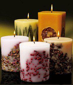 candele decorate con semi,foglie e frutta secca adattabili ad ogni ambiente.