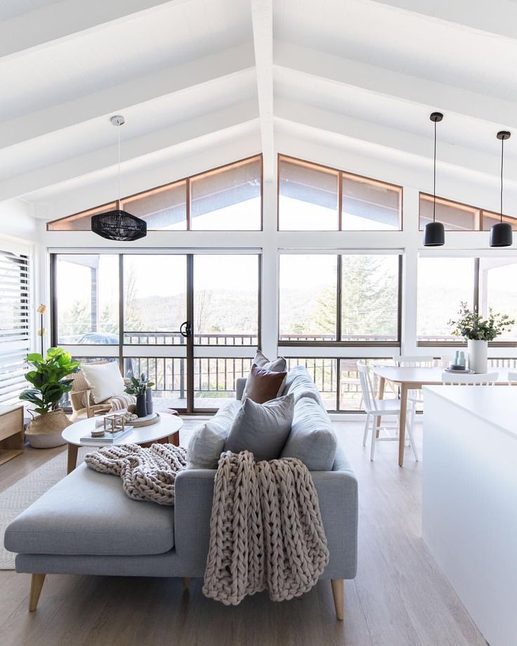 Open living / white grey palette / vaulted ceiling…