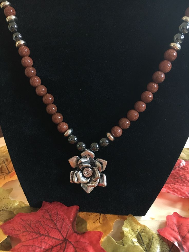 A personal favourite from my Etsy shop https://www.etsy.com/uk/listing/250173266/goldstone-and-hematite-necklace
