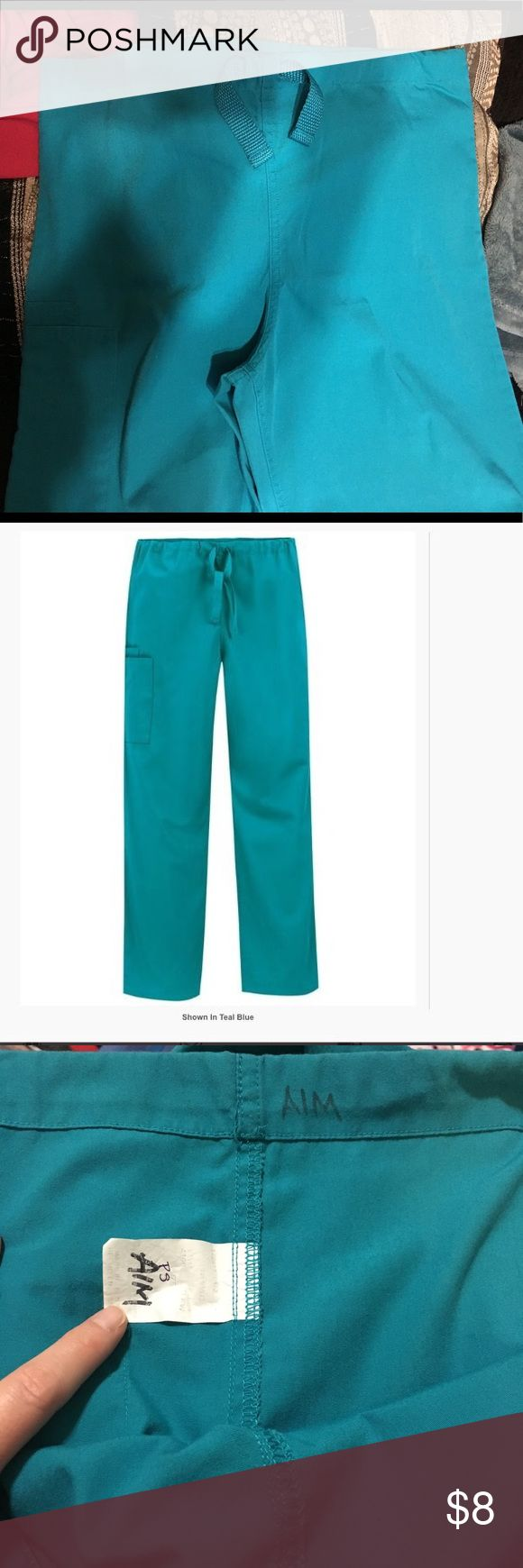 Teal Scrub Pants Used but in great condition. There's a few tiny spots on the legs but you can barely see them (shown in pic) and there's names written in sharpie on the tags & inside lining of them. (Shown in pics). These are unisex fit. Cherokee Pants