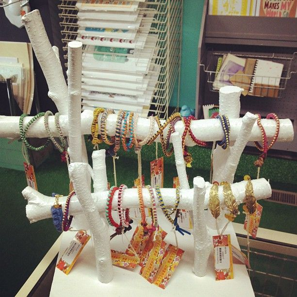 Painted natural wood bracelet display- I would leave natural or use birch trees