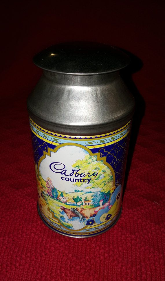 Charming Cadbury 1980s tin made in a milk can design, and probably used to sell Cadbury milk chocolate candy, (you think?)))). The sides of the tin are illustrated with cows out in country pastures in the midst of a colorful floral design. This item is marked on the bottom with made in England. I believe this tin to be in Ex/fine condition with no scratches or rust that I can see. Please inspect listing photos, (zoom feature) to determine condition. Thank you so much for visiting, and do...