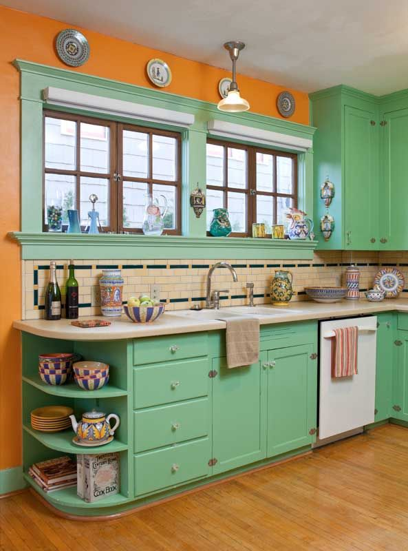 The use of period colors is evident in the kitchen of the restored 1906 bungalow. The maple strip flooring, top nailed, replicates the original damaged in a 1920s woodstove fire.
