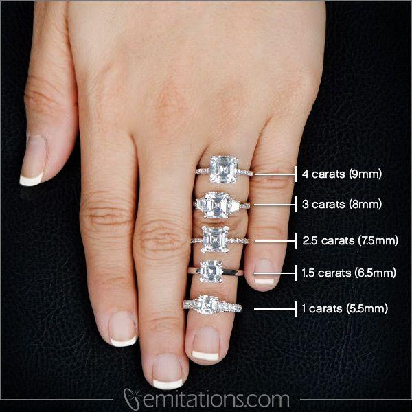 Asscher cut engagement rings on finger