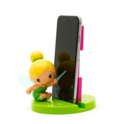 Keep your phone safe in style with our adorable Tinker Bell MXYZ phone stand! Featuring Tink's glittery wings, the cute stand is made from sturdy vinyl and has a built-in phone slot.