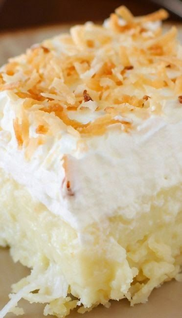 Coconut Cream Pie Bars - they are HEAVENLY: creamy coconut, a cloud of whipped cream, and a buttery shortbread crust. It doesn't get better than this for a coconut fan..