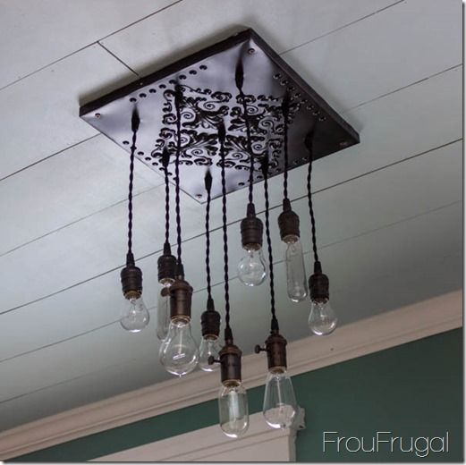 Edison bulbs + 1 inexpensive ceiling tile = uniquely gorgeous chandelier.