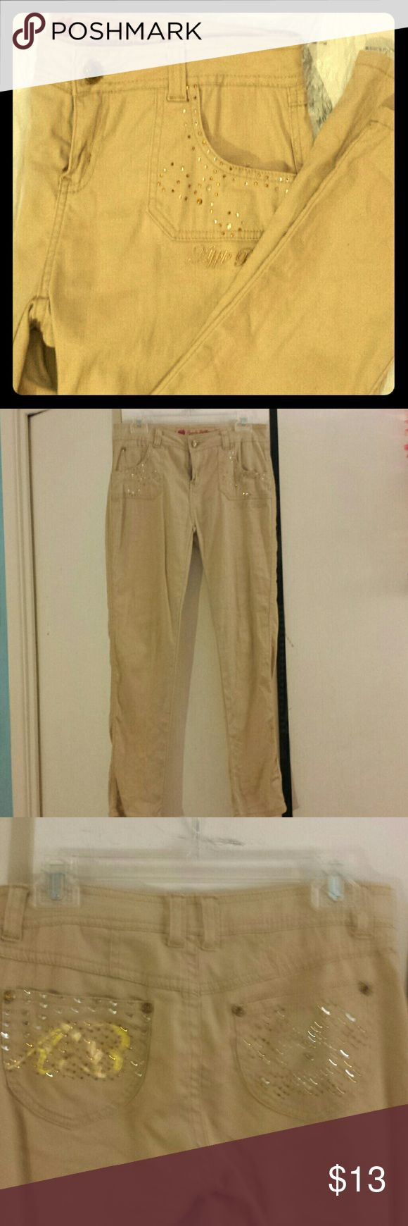 GIRLS' Apple Bottoms Jeans Tan Jeweled Pants Tan Apple Bottoms skinny cut pants with rhinestone decorations along the front and back pockets. Super chic and stylish for older girls/preteens. Size 16/XL could even fit a ladies XS or S. Please let me know if you have any questions or want more pics! Apple Bottoms Bottoms Jeans