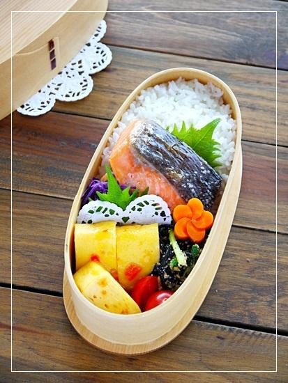 Grilled Salmon, sesame-komatsuna, sweet chili egg, hana carrot, and rice.