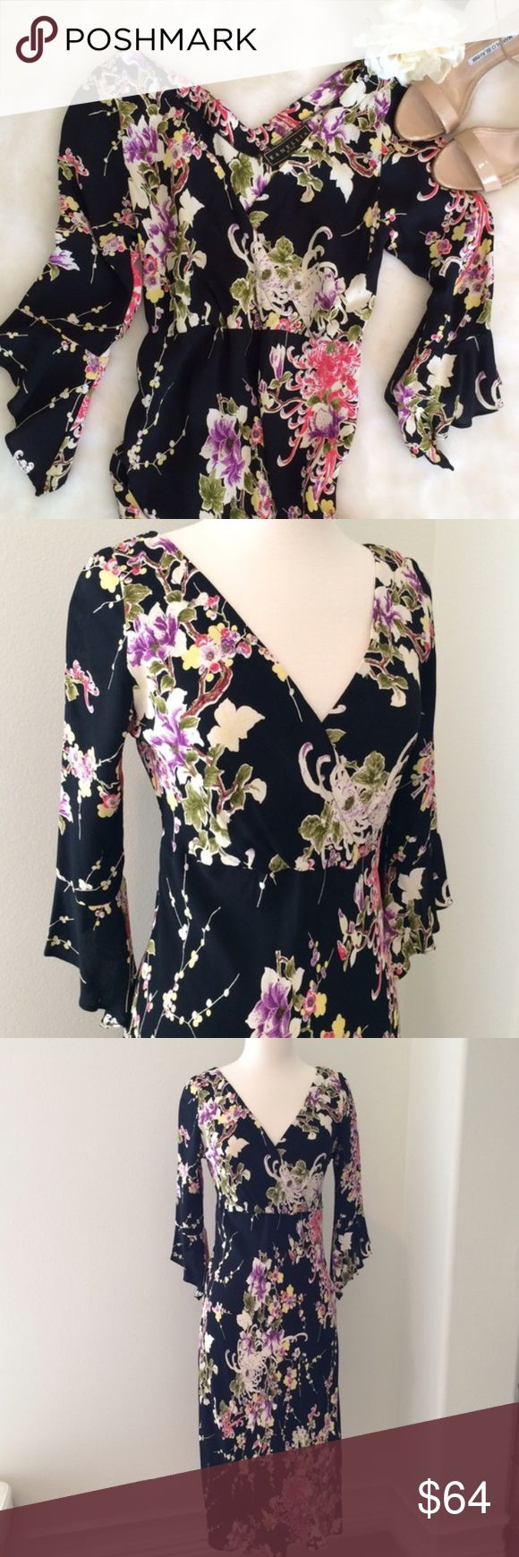 Floral Surplice dress with 3/4 sleeve Like new floral Surplice dress with 3/4 flutter sleeves. Looks beautiful on. Worn once. Figure flattering! Can fit Small or small medium Kamelia Dresses