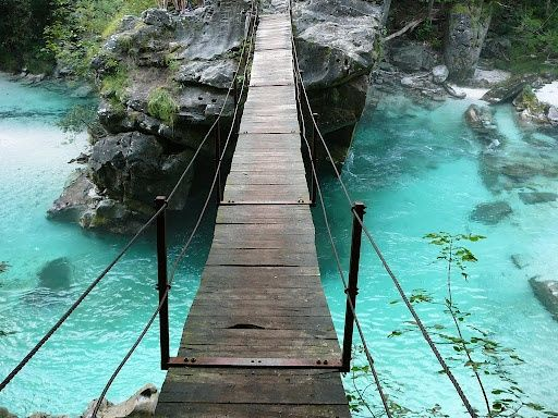 Soca River in Slovenia. I've stood on this bridge over the amazing turquoise water :)