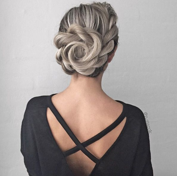 Side rope braid into flower bun by Nina Starck