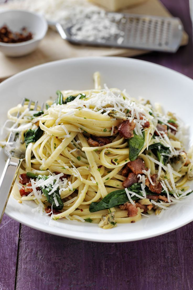 A classic linguine with clam sauce recipe gets a major upgrade with leafy green spinach and crispy bacon bits.