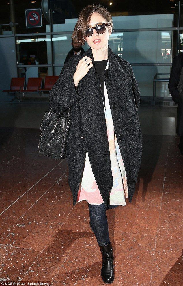 Salut! Hollywood actress Lily Collins was spotted arriving at Paris' Charles de Gaulle on ...
