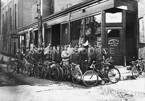 "Members of Springfield, Massachusetts's ""Moto Cycle"" Club with Indian-brand motorcycles, in front of their clubhouse, early 1900's.  © Patrick W. Grace/Photo Researchers, Inc. #historical #bw #vintage #motorbike #stockphotography #portrait #sciencesource"