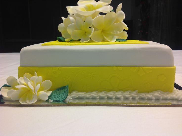 Bright yellow & white frangipani flowers chocolate mud cake for any occasion.