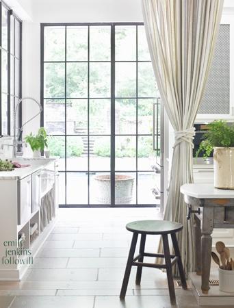 light filled kitchen. more black frame doors/windows