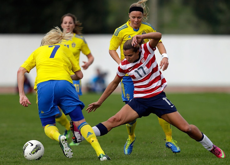 Tobin Heath, right, of the US challenges Sweden's defense during their Algarve Cup women's soccer match Monday, March 11 2013, in Lagos, southern Portugal. (AP Photo/Armando Franca)