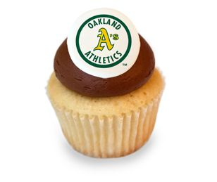 Vanilla Chocolate A's Cupcake. A vanilla cupcake with a sugary sweet chocolate frosting decorated with an edible A's logo. #karascupcakes #oaklandathletics
