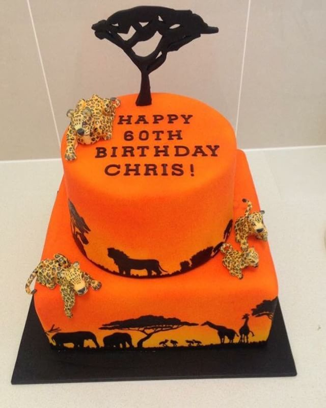 Hand Painted African Safari Sun Set Cake. Complete with edible fondant leopards and tree! #africansafarisunsetcake #safaricake #safarisilhoettecake #satinice #cake #fondant #homemade #madewithlove #familytraditions #airbrush #handpainted #leopards