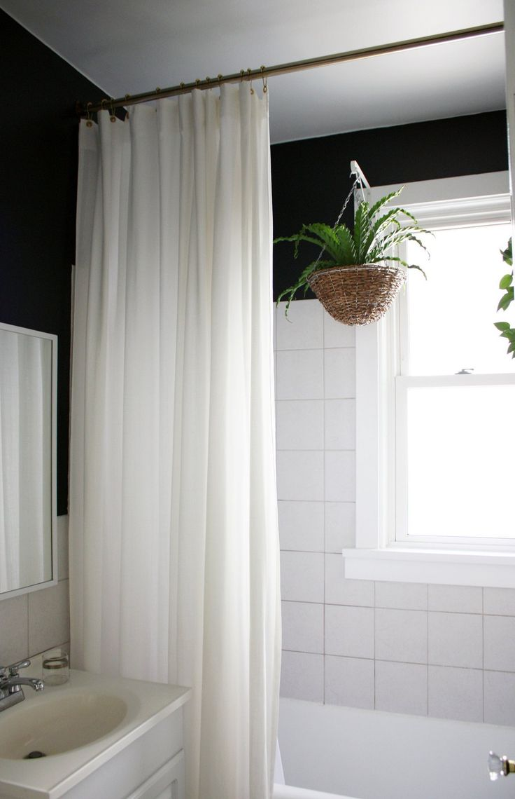 plants in the bathroom...I like the graphic contrast in the BD .... Marti & Jarrod's Graphic Modern Home