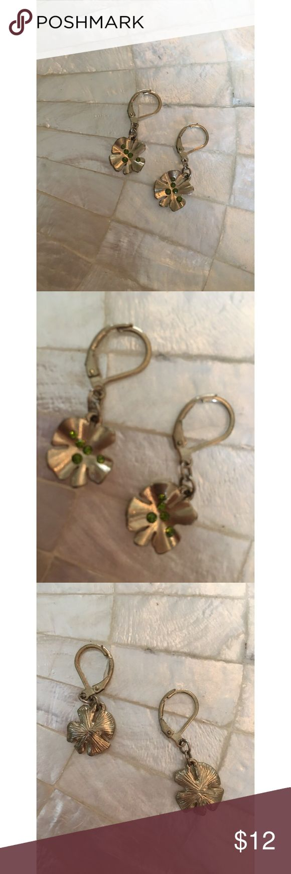 Lucky Clover Earrings These lucky clover earrings by Lauren Conrad are a cute accessory, gold in color with light green stones. VGUC only worn once. LC Lauren Conrad Jewelry Earrings